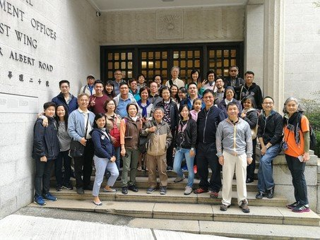 Group photo with Dr. Ting in front of Central Government Offices