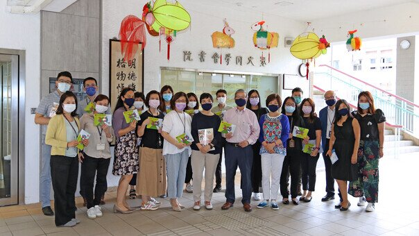 Dr. Kenneth Tse, Chairman of the Foundation, and two school Supervisors distribute the reusable face masks to College staff